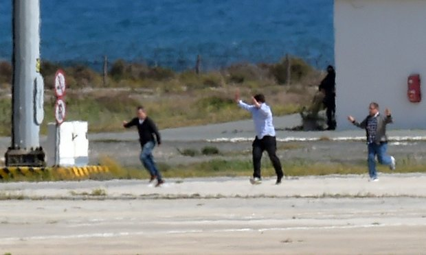 The last three passengers on the hijacked EgyptAir flight MS181, including Briton Ben Innes, centre, run across the tarmac after leaving the plane.