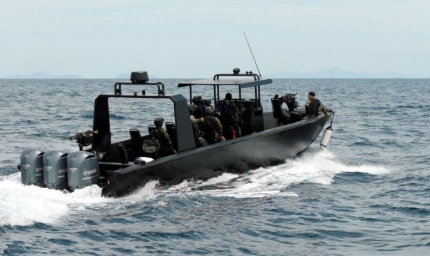 Security forces are seen patrolling Semporna waters.