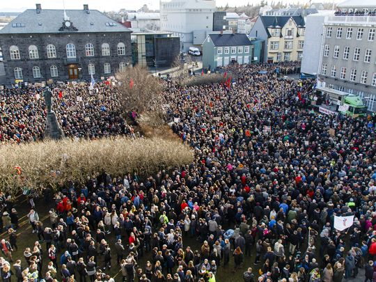 People gathered during a protest on Austurvollur Square in front of the Icelandic Parliament in Reykjavic, Iceland, on 4 April.