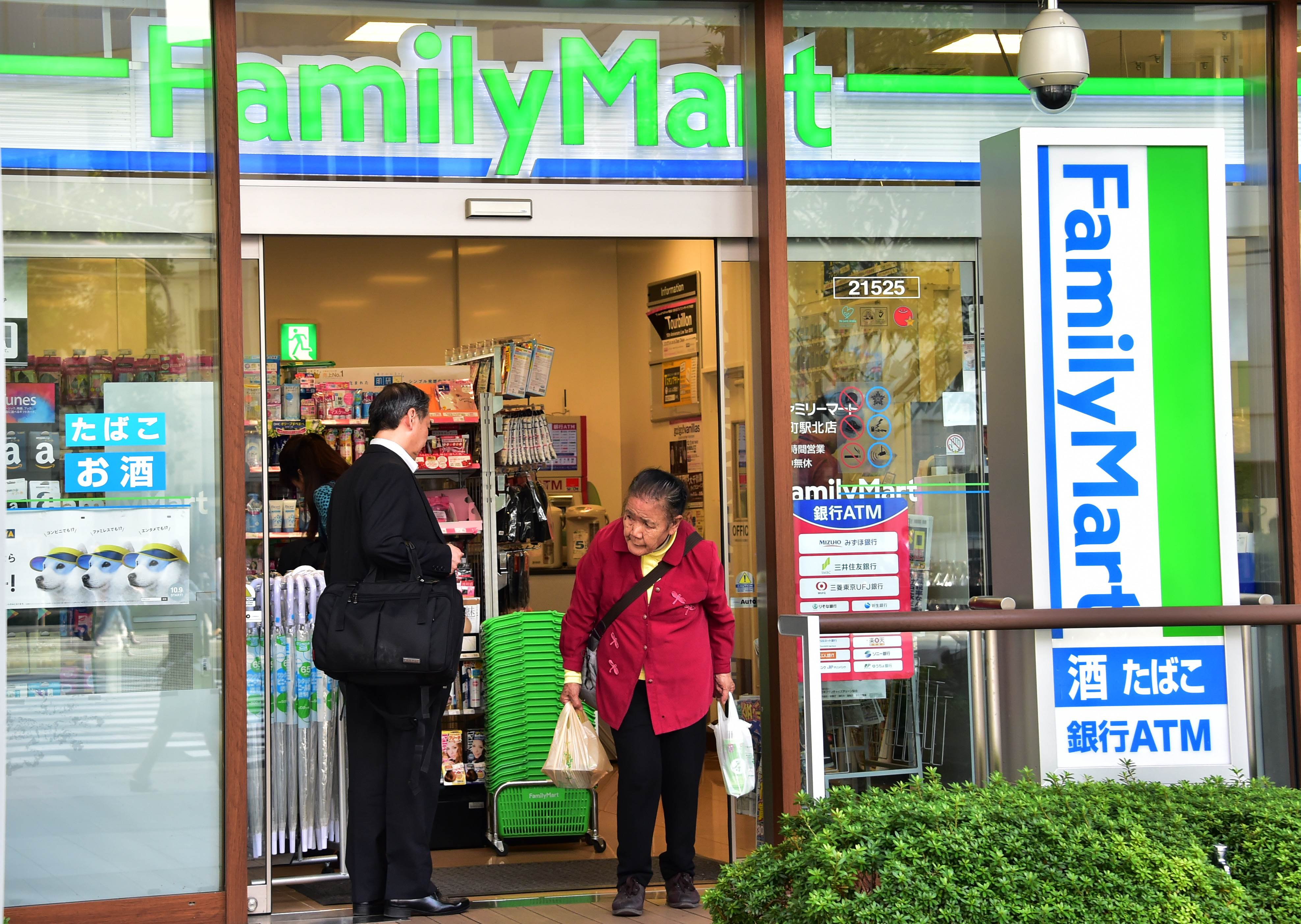 Customers at a FamilyMart convenience store in Tokyo.
