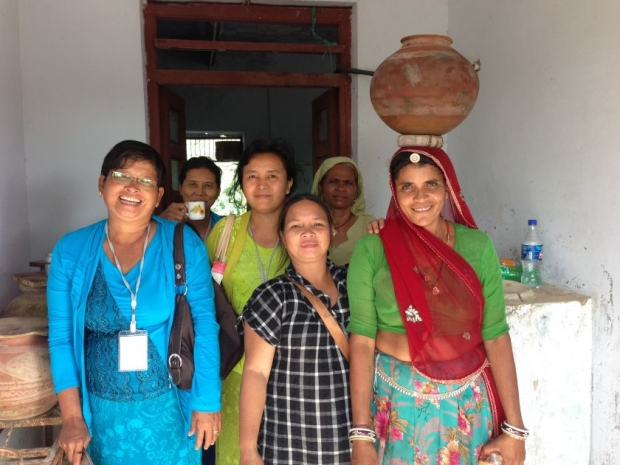 "'Tarihing Masanim (centre) with other participants of the ""Grandma Solar Engineer"" programme from Barefoot College in India'"