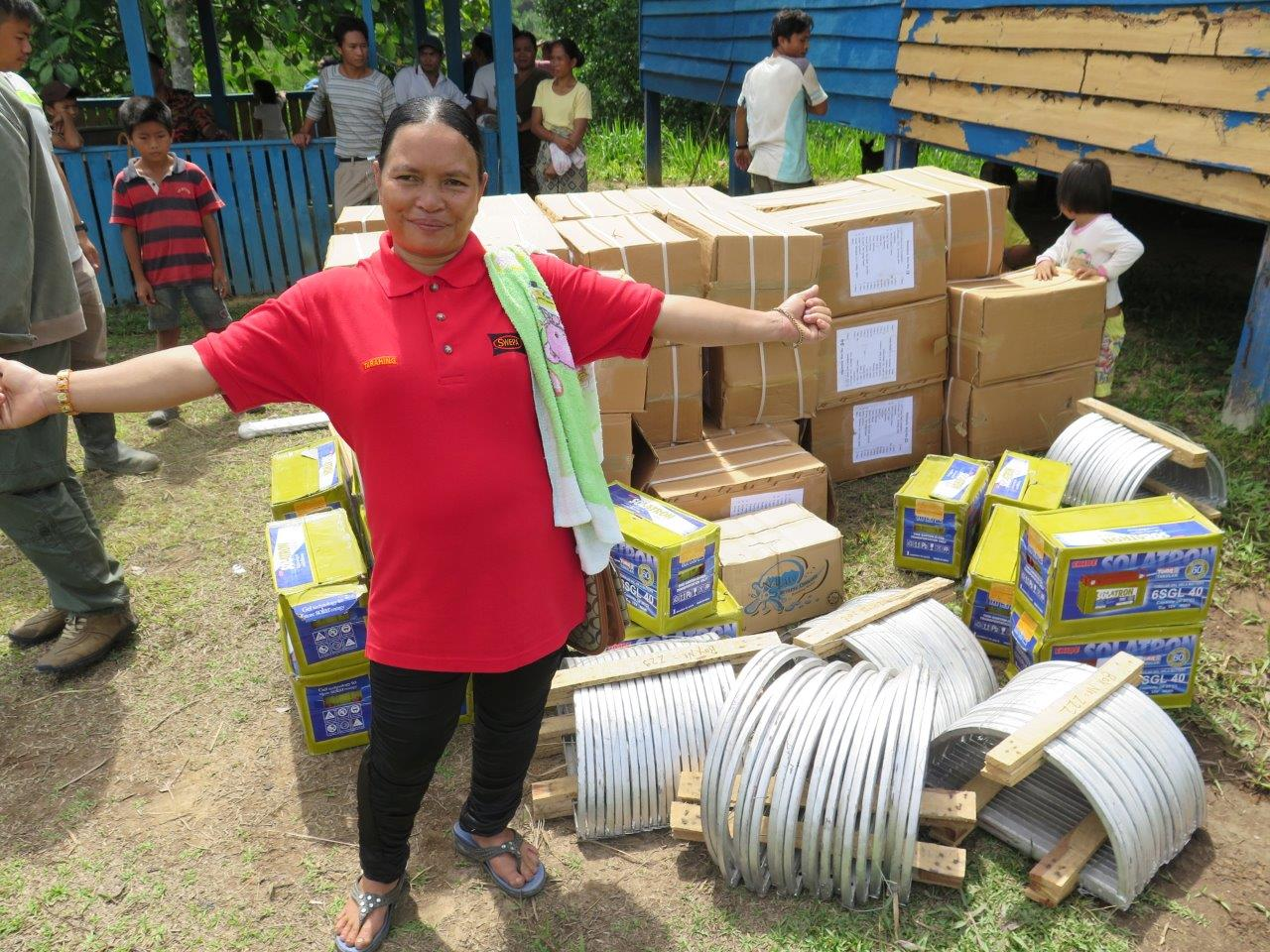 Tarihing photographed with all the solar equipment needed for her village
