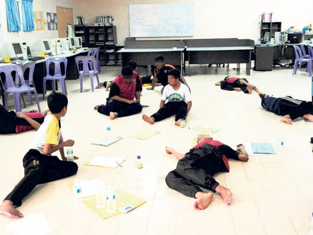 Male students of SMK Tok Kera, Kuantan are left exhausted after a bout of hysteria in 2013.