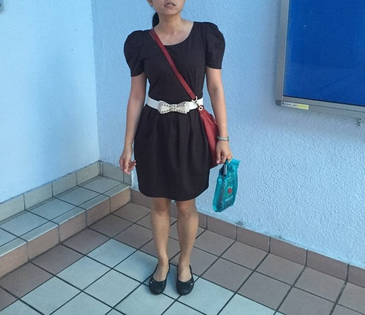 Jesslyn wore a black dress with short, puffy sleeves and a slightly above knee-length hem to DBKL.