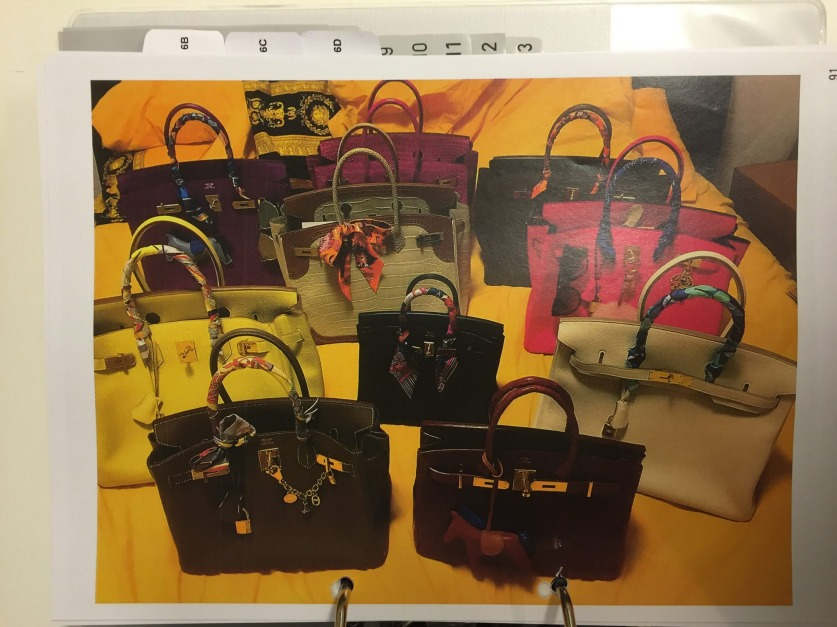 Some of the hundreds of designer handbags seized from Christine Jia Xin Lee's unit in Rhodes.