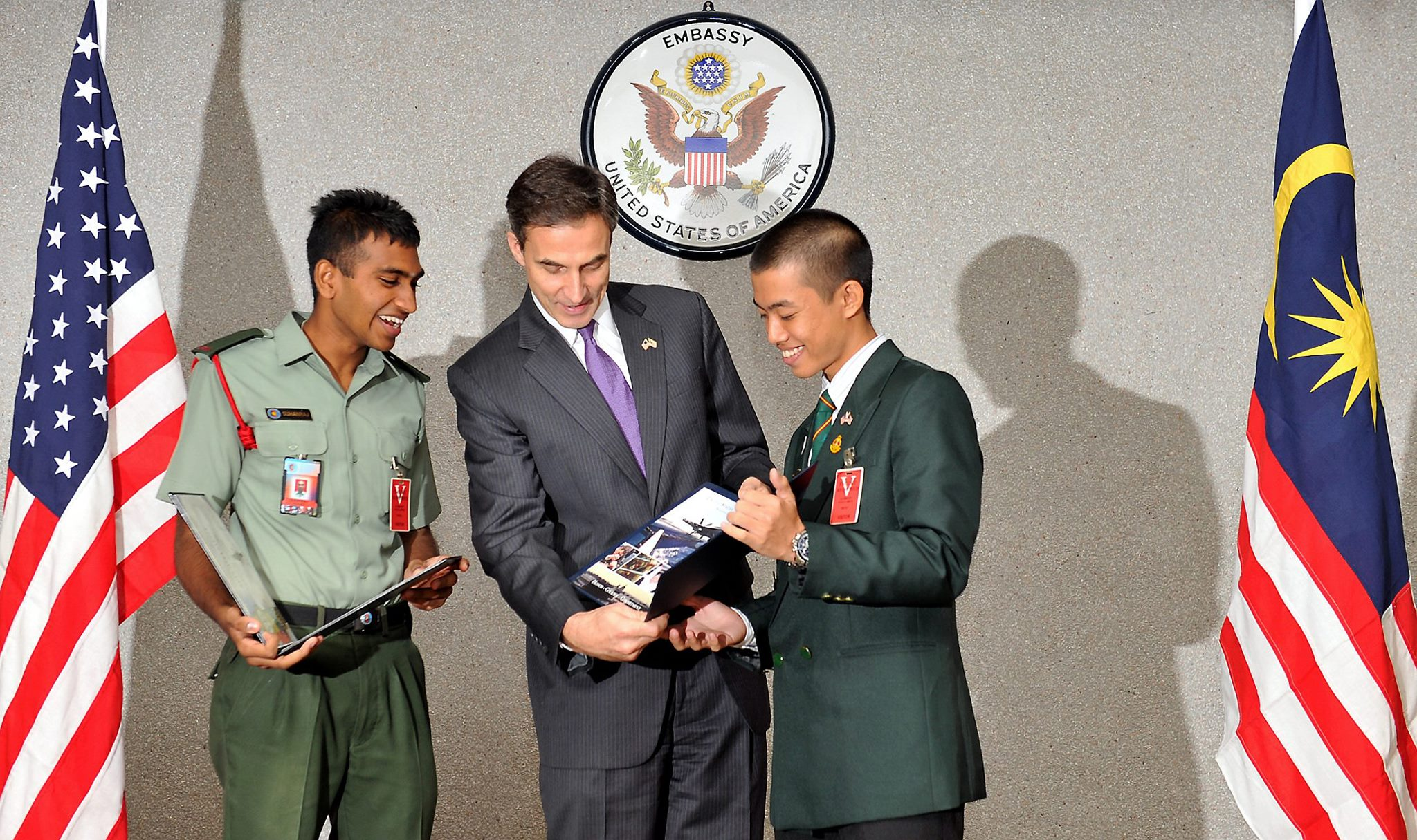 The then US Ambassador to Malaysia Paul W. Jones presented to Suhanraj Rajasegaran (left) and Chan Jun Kwan (right) the scholarship to attend the United States Services Academy in 2012.