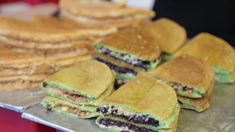 Pandan flavoured *apam balik* with fillings such as *pulut hitam*, raisins, chocolate, and coconut.