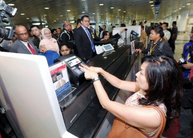 An undated photo of a tourist going through the biometric procedure at the KLIA Airport.