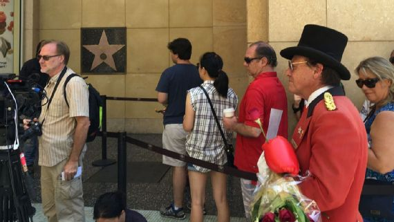 Fans wait to pay their respects to Muhammad Ali's star on the Hollywood Walk of Fame.