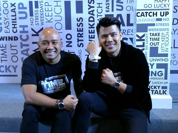 CEO of Touch 'n Go Syahrunizam Samsudin (Left) and actor Awal Ashaari (Right) posing with their new TimeTraveller watches