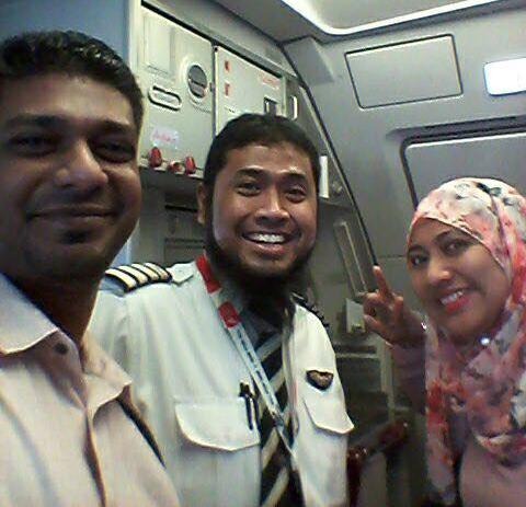 Captain Shaha (middle) with two of his passengers.