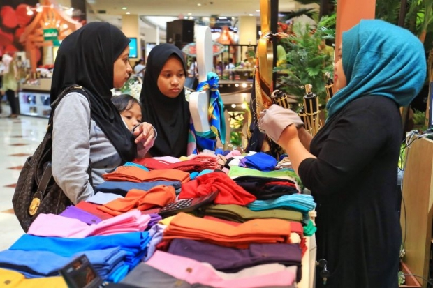 A few ladies shopping for headscarves at KLCC shopping mall on 16 July.