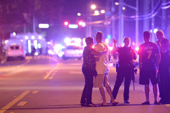 Police officers in Orlando, Fla., directing people away from a nightclub where a gunman opened fire early Sunday.