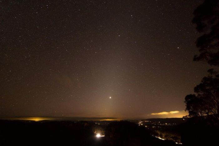 Image captured from the Blue Mountains features planet Venus glowing above the horizon, referred to as zodiacal light.