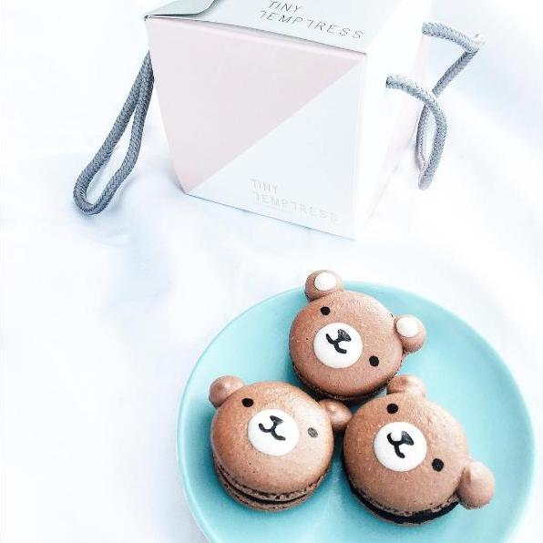 Chocolate macarons shaped like bear faces.