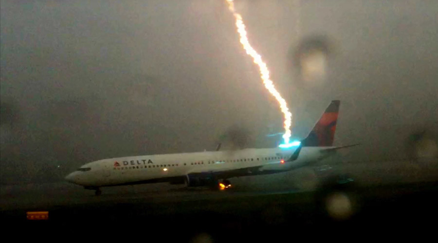 Screenshot of a video that captured the moment when a Delta plane was struck by a powerful lightning bolt while on a runway in Atlanta last year.