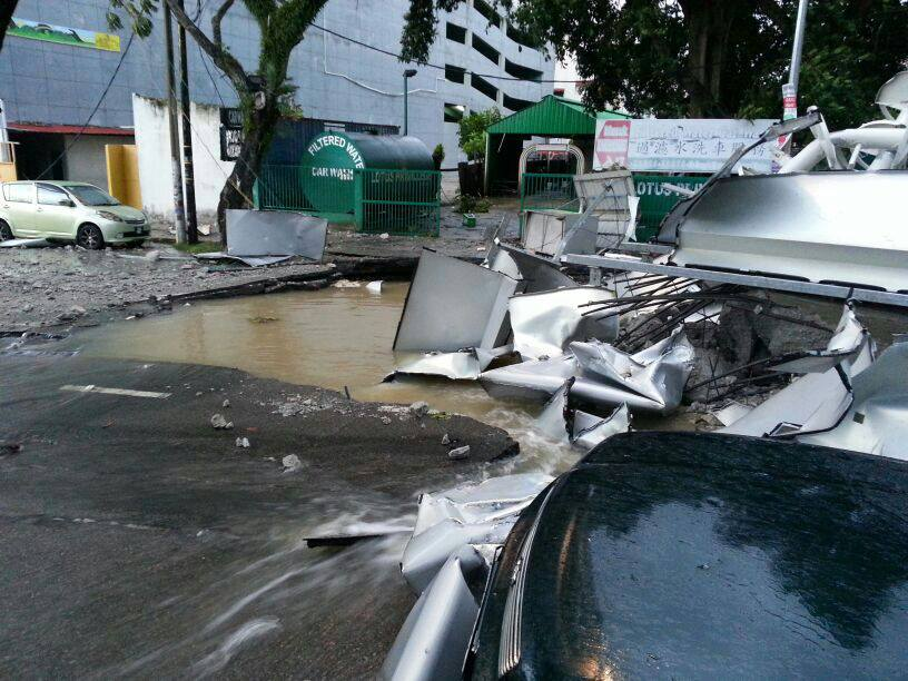 [VIDEO/PICS] Storm In Penang: Missing Hawker Laid To Rest