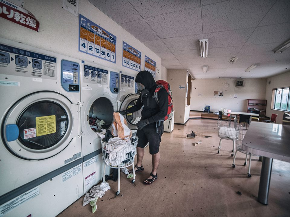 Laundry left behind in a laundromat in the red zone. Keow notes that there are also 100 yen coins lying around.