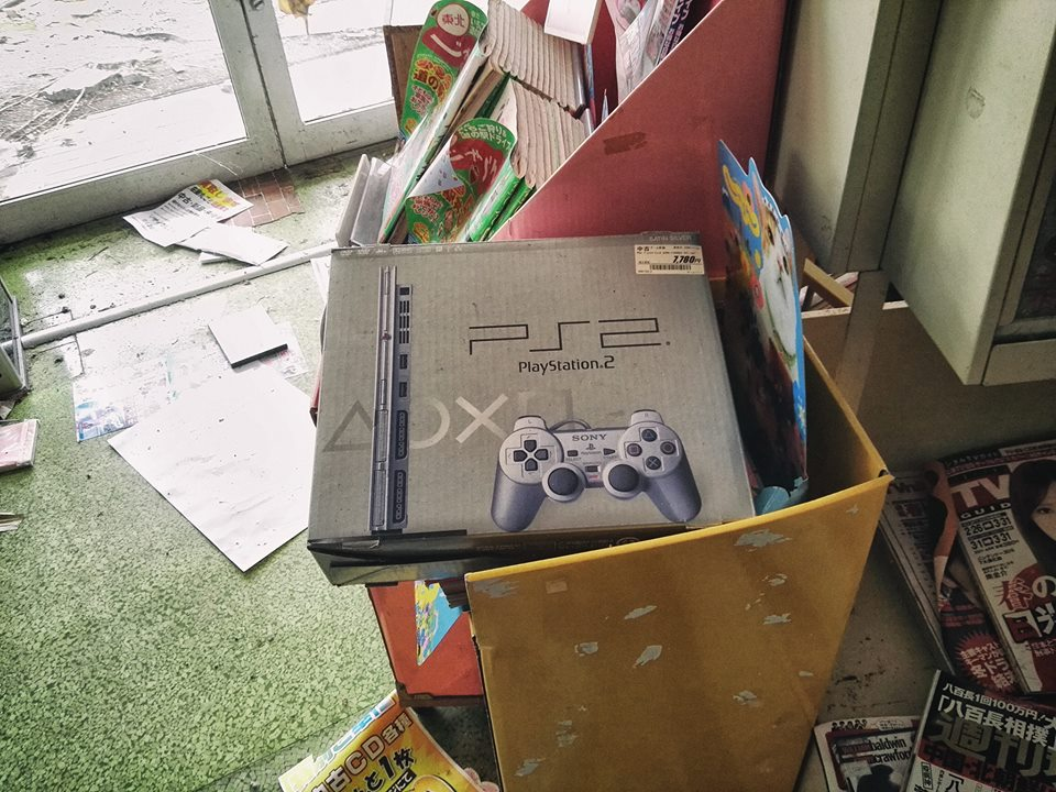 An unopened box of PS2 in an abandoned home.