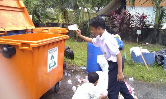 Pick up rubbish from the school compound.