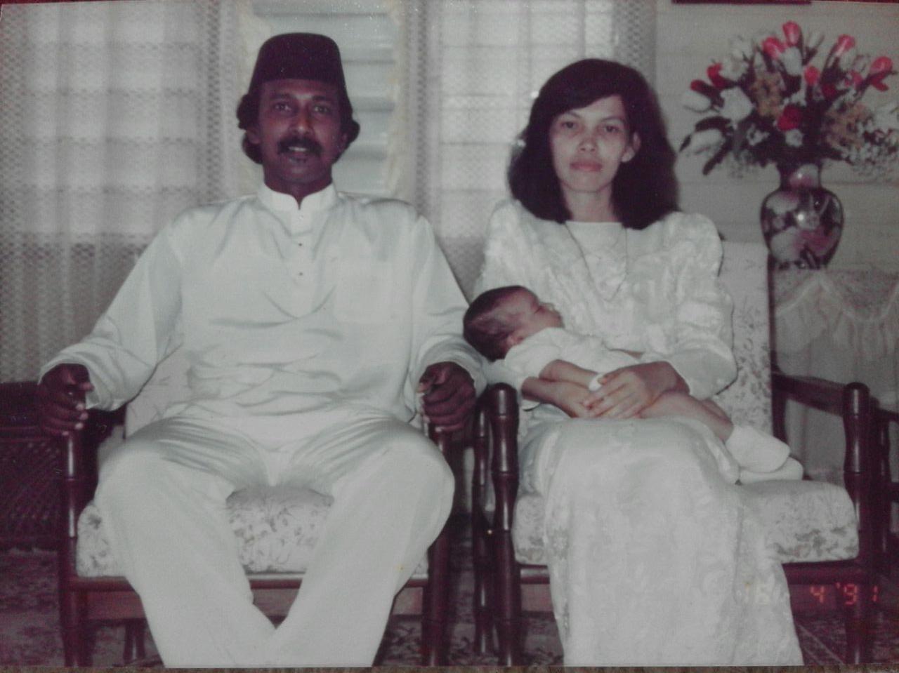 Mohamad Redza Ramadas Abdullah and wife, Halimah Baharudin with their first child, Redzalina