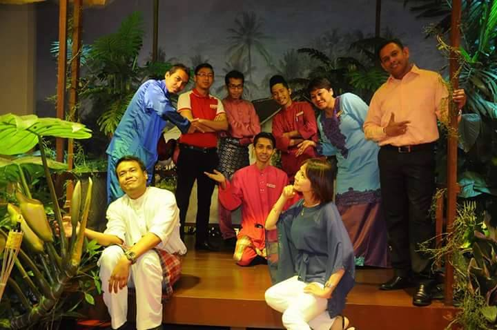 Adam (bottom left) with his colleagues during Hari Raya celebration last year.