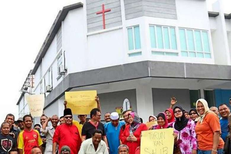 Muslim protesters photographed during their protest over the cross signage on a church building in Taman Medan.