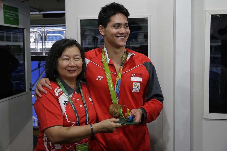 Joseph Schooling with his mother May after winning the men's 100m butterfly final in Brazil.