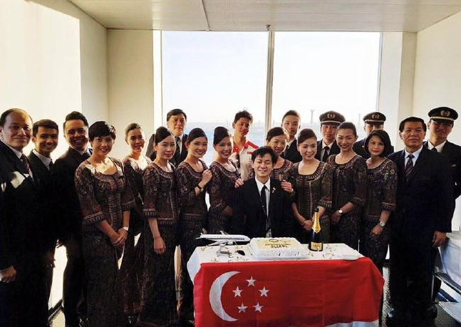 Gold medallist Joseph Schooling, pictured in the back row, flanked by Singapore Airlines staff in the post, which has since been deleted.