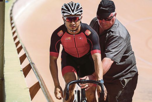 John Beasley (right) vowed that he would do anything to help national cyclist Azizulhasni Awang to excel in the Olympic Games earlier this year.