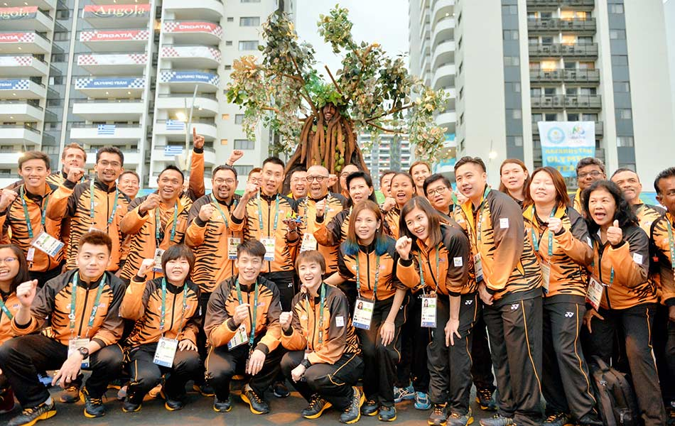 The Malaysian Olympic contingent shouting out 'Malaysia Boleh' after the 'Jalur Gemilang' was raised at the Games Village in Brazil on 2 August.