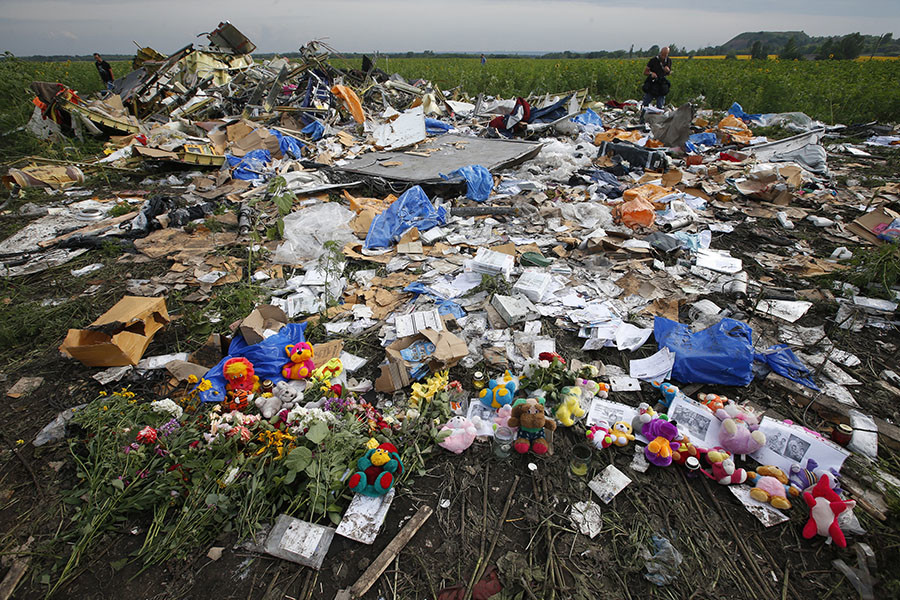 Flowers left by local residents at the crash site of the Malaysia Airlines Flight MH17. The plane was shot down 17 July 2014, killing all 283 passengers and 15 crew on board.
