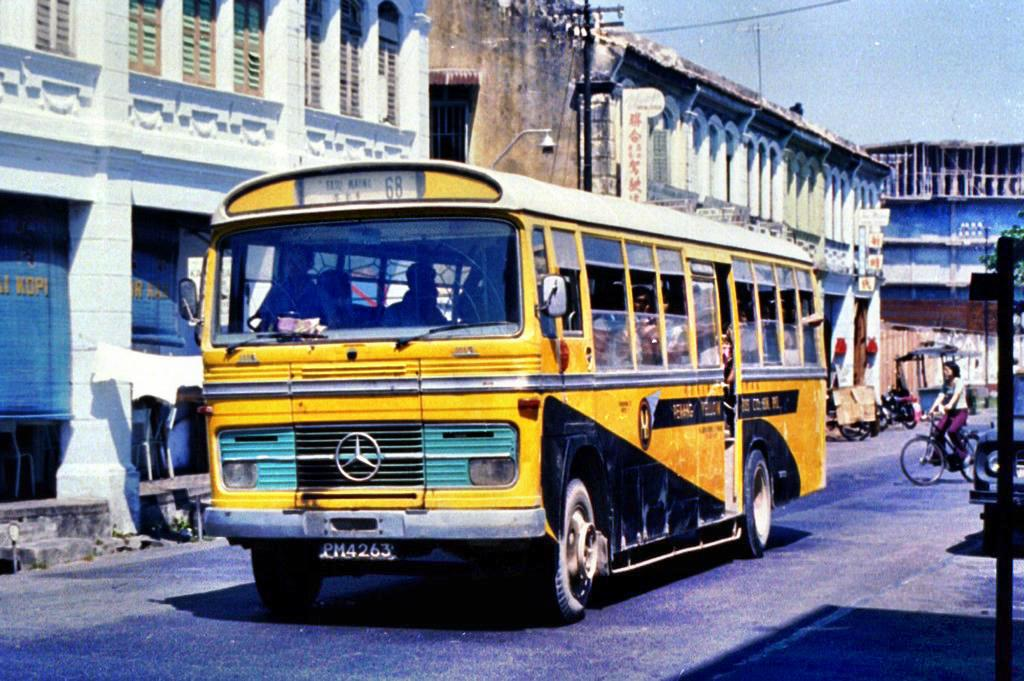 The Penang Yellow Bus Company Mercedes-Benz 1113 was photographed by Peter Vasey in 1976.