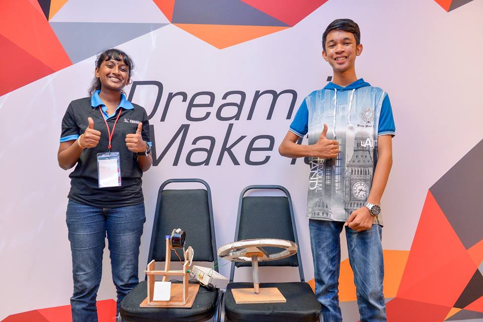 Gayatri (left) and Badrul (right) with their invention at DMGX.