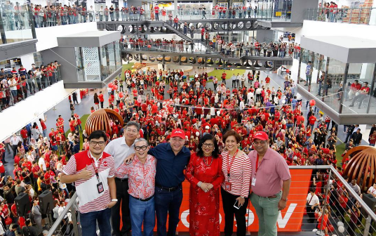 AirAsia and AirAsia X staff posing for a photo in the RedQ.