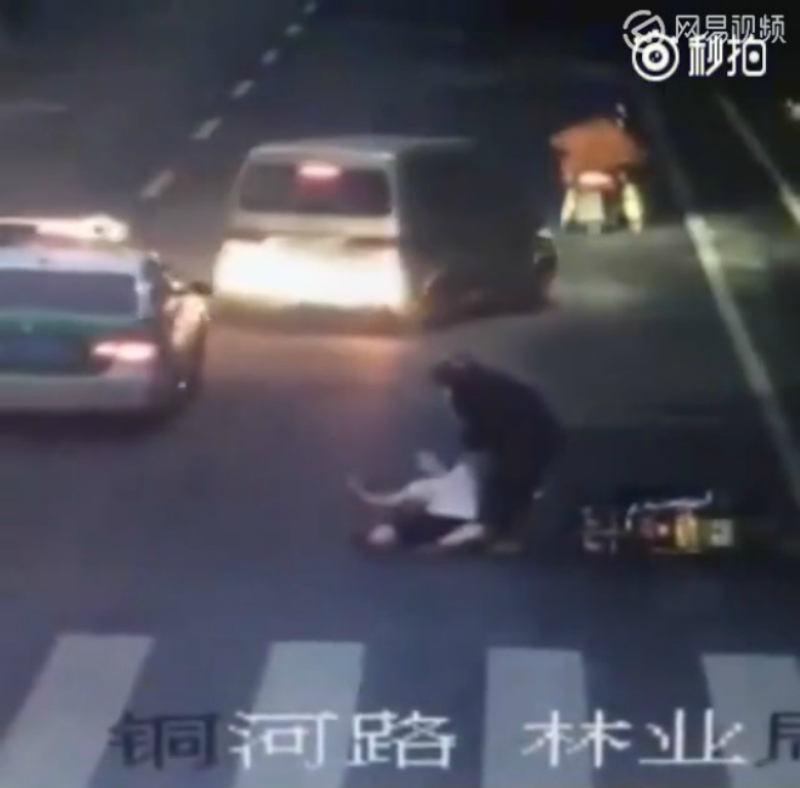 The motorcyclist was seen trying to help the woman before speeding off.