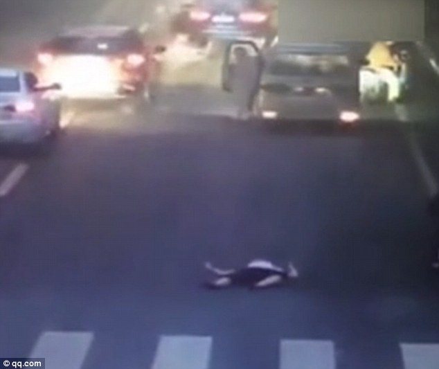 Zhang was left lying in the middle of the busy road after the hit-and-run accident.