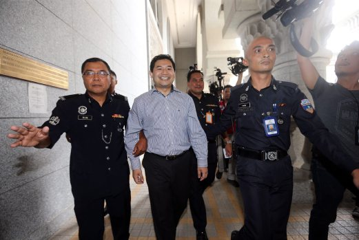 Pandan MP Rafizi Ramli (second from left) was arrested and charged in April this year.