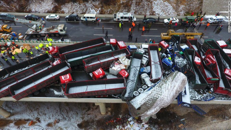 Aerial view of damaged vehicles after the pile-up on the Beijing--Kunming Expressway in north China's Shanxi province.