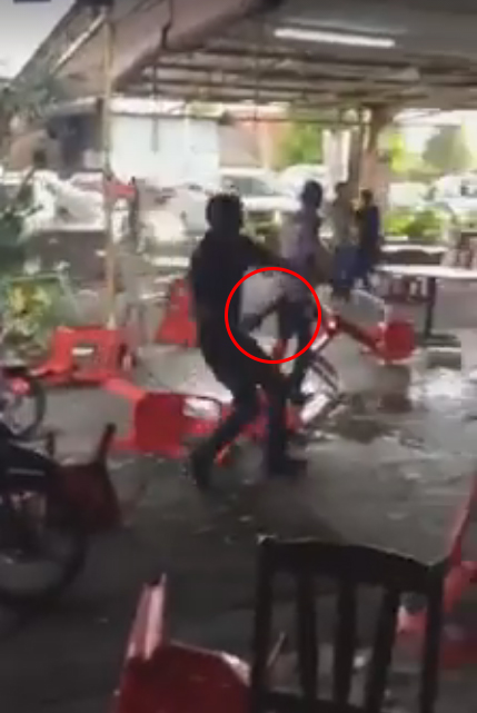 One of the men in the video were seen holding something that appears to be a parang.