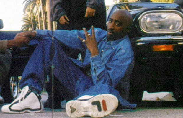 The late Tupac Shakur rocking a pair of Fila sneakers.