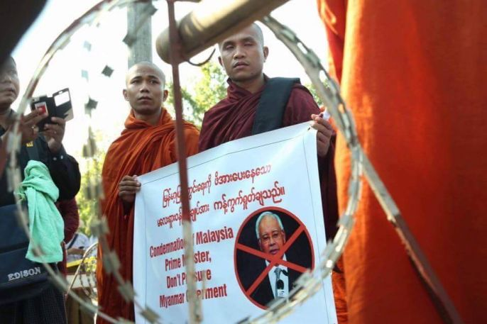 Monks protesting against PM Najib Razak on Saturday, 4 December for his interference in the Rohingya issue.