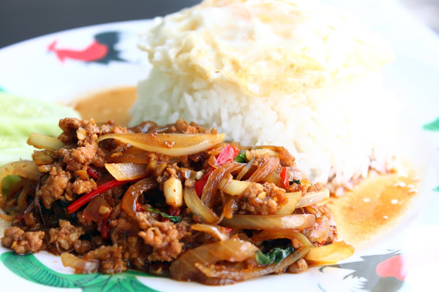 The classic Thai braised pork served with rice and a sunny side up.