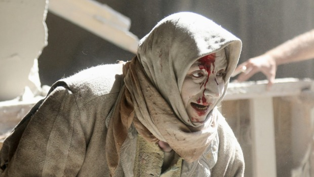 An woman injured by airstrikes in Aleppo.