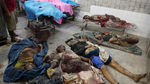 The bodies of Saudi-led airstrike victims in the rebel held port city of Hodeida on 21 September 2016.