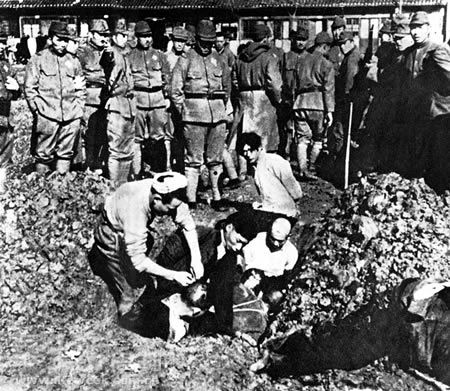 Japanese soldiers burying Chinese civilians alive during the Nanking Massacre.