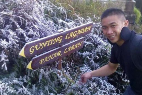 A photo from 2014 featuring a man with plants covered with ice.