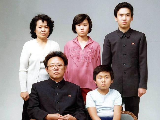 Kim Jong-Nam sitting with his father (left) while his aunts and cousins stand at the back of them for a photo in 1985.