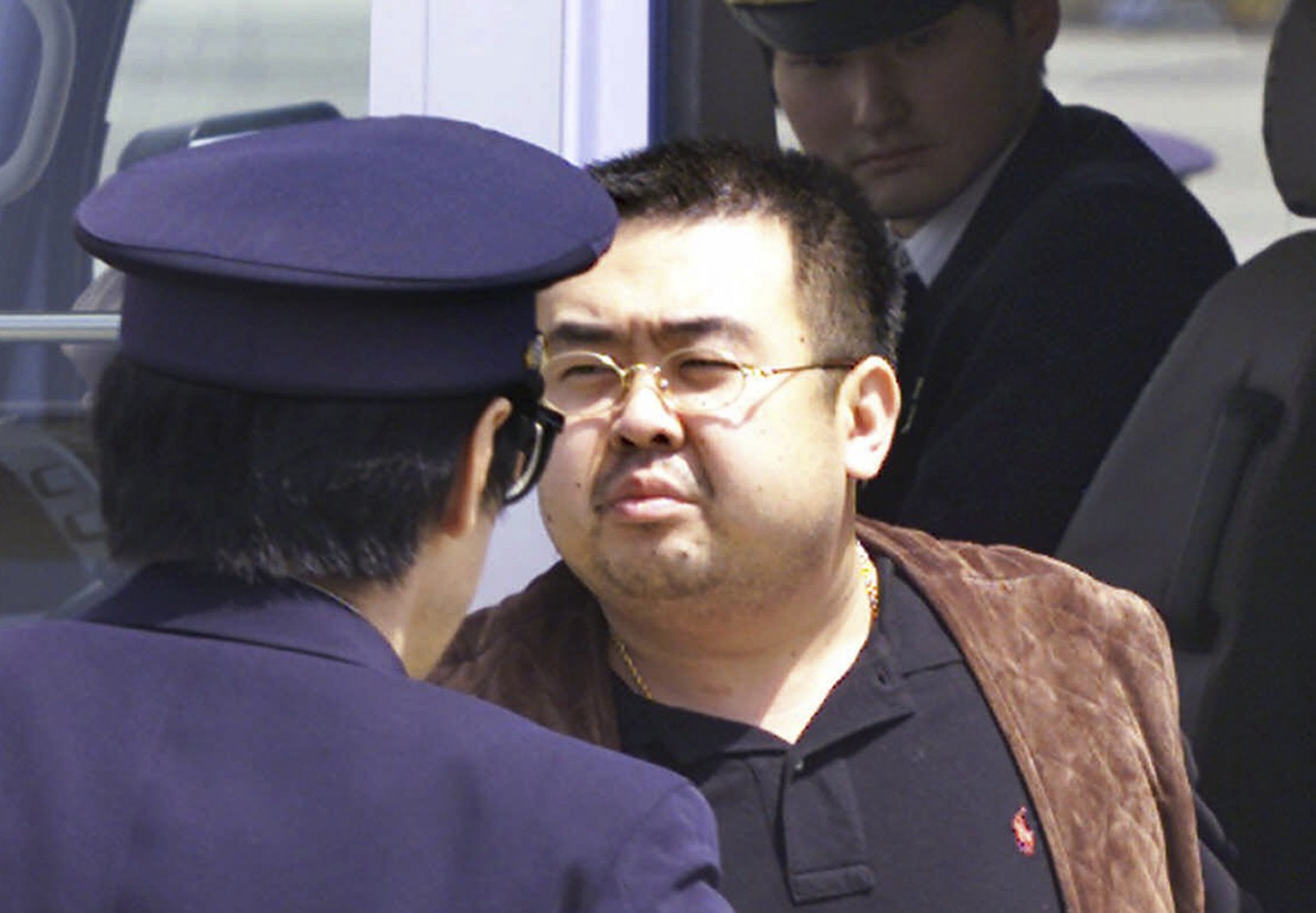 A photo of Kim Jong-Nam in 2001 where he was escorted by Japanese police at the airport in Narita, Japan.