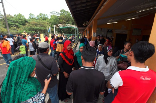 Family members of the victims gathered at Sultanah Aminah Hospital on 18 February.